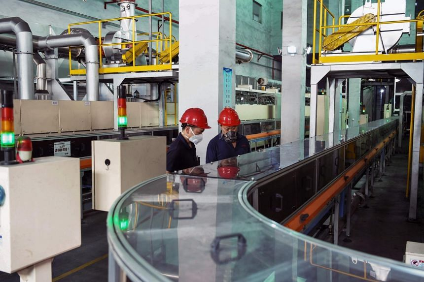 Employees working on a lithium battery production line at a factory in Haimen in China's eastern Jiangsu province.
