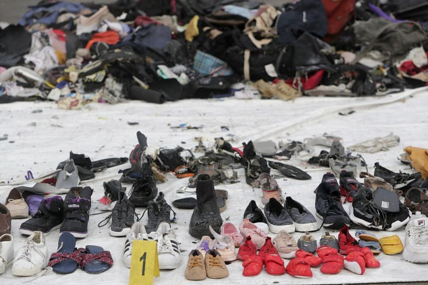 Shoes belonging to victims of the Lion Air flight JT-610 plane crash at the collection point at Tanjung Priok Harbour, Jakarta, Indonesia, on Oct 31, 2018.