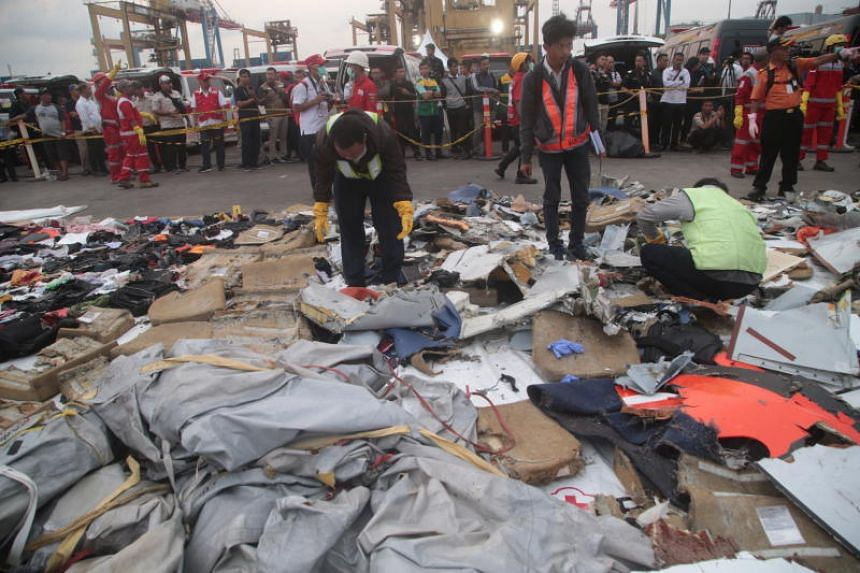 Rescuers were recovering belongings of those on board - passports, children's shoes, identity cards - and officials picked through them to help make identifications.