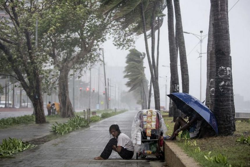 Typhoon Yutu, which caused devastation in some Western Pacific islands, swept across the Philippines on October 30, toppling electric posts, tearing roofs off homes, bending trees and pouring sheets of rain, across the northern half of Luzon.
