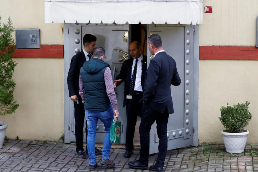 Security officers at Saudi Arabia's consulate in Istanbul. Turkey's chief prosecutor said Mr Jamal Khashoggi was strangled to death as soon as he entered the consulate.
