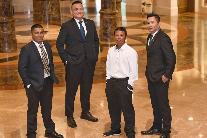One Degree 15 Marina Sentosa Cove employees (from left) Mohd Fadhlul Rahman Abu Bakar, Mohammad Nazir Lajis, Muhamad Sunasri Samat and Azhar Hamid each received a Special Mention award yesterday for helping to put out a fire on a boat after an explos