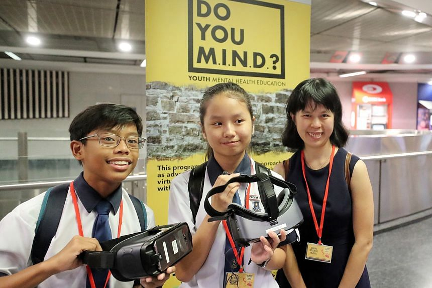 Above: Students wearing a VR headset will take on the persona of a virtual character - a girl who suffers from depression - and listen to her inner thoughts. Left: Hougang Secondary students Malabanan Ace Brendan Malones, 13, and Phoebe Teo Jianing,