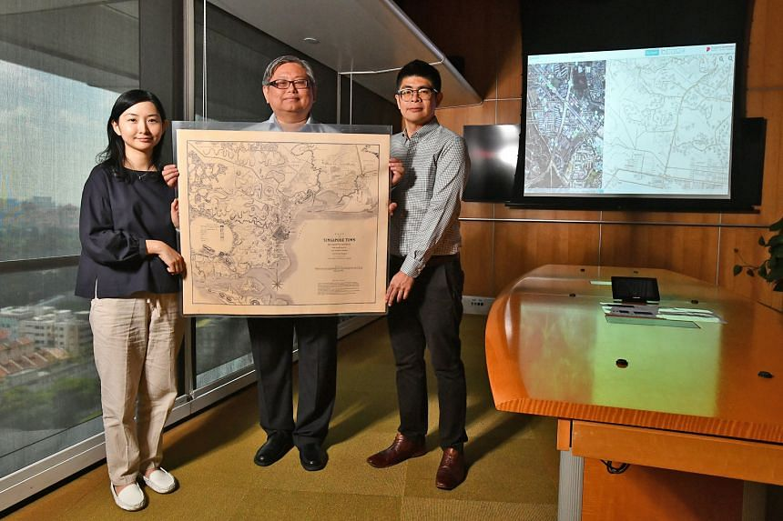 Mr Yit Chin Chuan, 51, NAS' assistant director, archives services; flanked by Ms Loh Yuexia, 36, an assistant archivist; and Mr Patrick Cher, 32, a project manager; with the 1846 plan of Singapore produced by government surveyor, architect and engine
