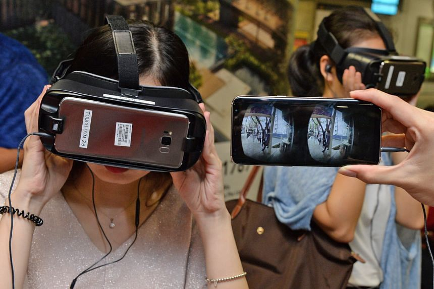 People trying out a virtual reality (VR) headset that gives them a two-minute, first-person view of a girl with depression and lets them hear her inner thoughts. The VR experience launched yesterday is part of a programme, Do You M.I.N.D.?, by Touch
