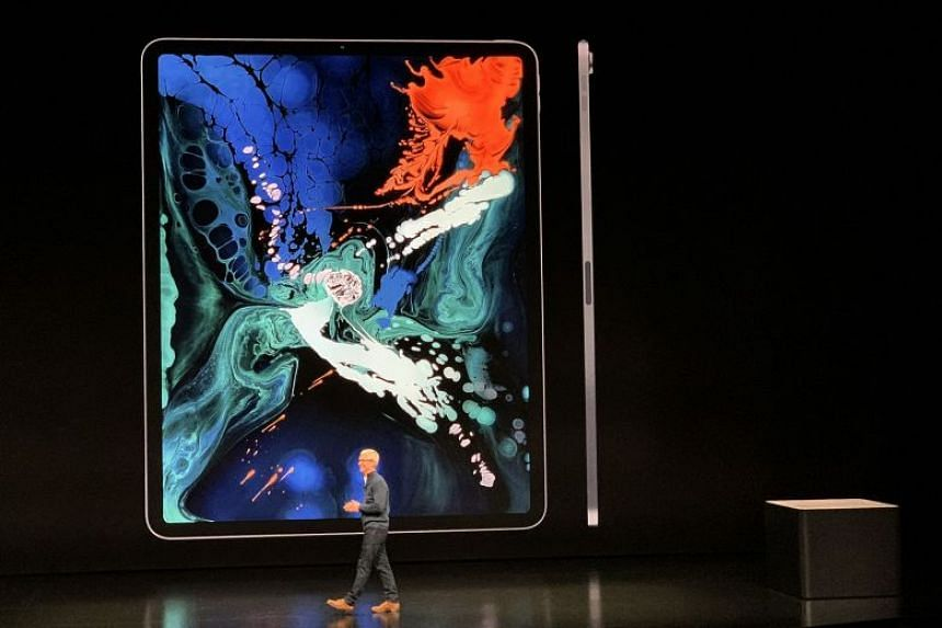 Apple CEO Tim Cook unveiling the new iPad Pros at the special event in New York City.