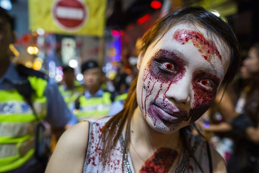 Costumed revellers attend Halloween celebrations in Lan Kwai Fong in Hong Kong, China, Oct 31, 2018.
