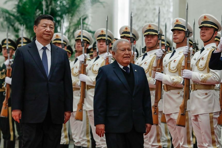President Xi Jinping and President of El Salvador Salvador Sanchez Ceren inspect an honor guard during a welcome ceremony at the Great Hall of the People in Beijing, on Nov 1, 2018.