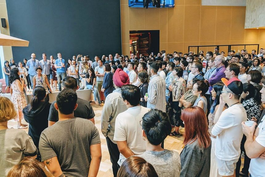 Google Singapore's employees gather in a common area to attend the Google Walkout on Nov 1, 2018.