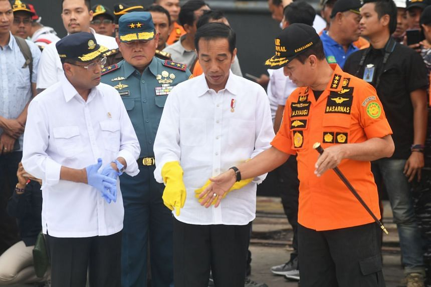 Indonesia's Minister of Transportation Budi Karya Sumadi (left) said President Joko Widodo (centre) had ordered a review of all flight safety regulations after the crash.