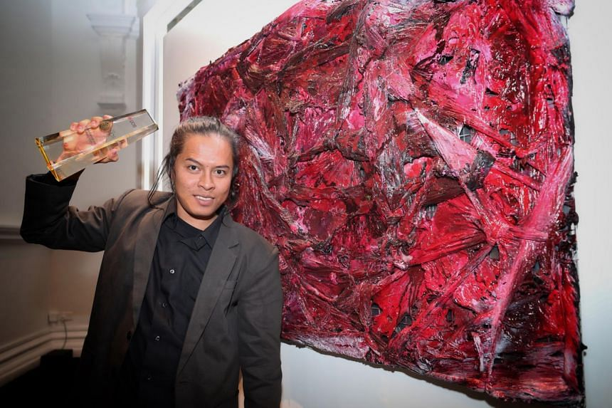 Mr Suvi Wahyudianto, winner UOB Southeast Asian Painting of the Year, poses with his painting titled Angs't (ANGST).