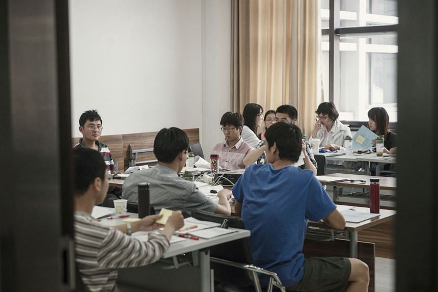 Students in a class at Renmin University. According to NYTimes, Renmin had punished at least a dozen students for defending workers' rights.