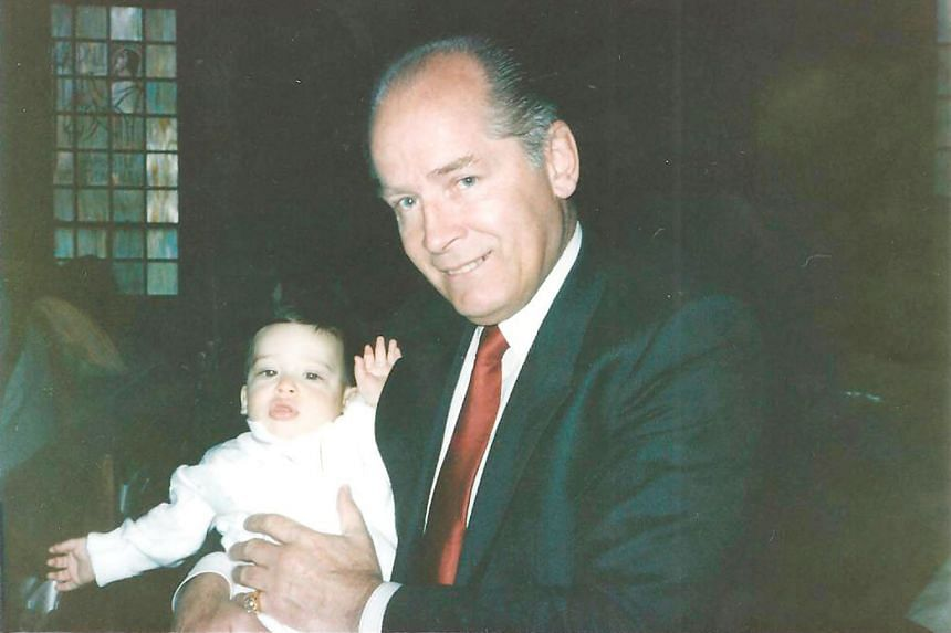 James Bulger holding fellow gangster John Martorano's youngest son, John Jr, during his christening ceremony in this undated handout photo provided by the US Attorney's Office of Massachusetts. Bulger was convicted in August 2013 of 11 murders, among