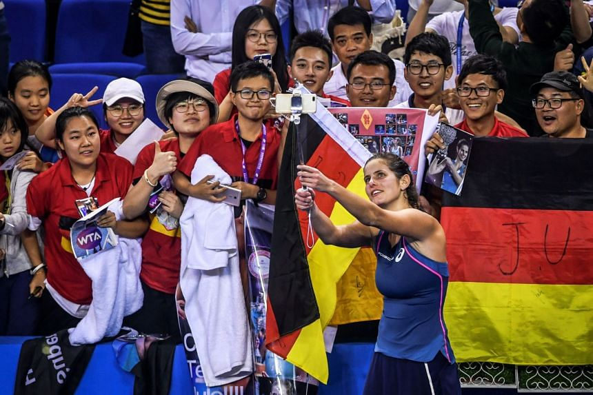Goerges takes a selfie with her fans after her match against Elise Mertens of Belgium.