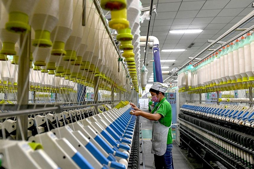 An employee at a textile factory in Shangqiu, Henan province. The statement from China's politburo meeting signalling that further stimulus measures are being planned came hours after purchasing manager reports showed an across-the-board deterioratio