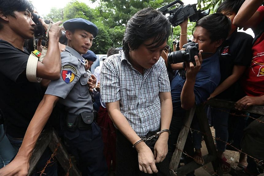 Nayi Min, one of three journalists from Eleven Media group arrested for incitement on Oct 10 after the Yangon region government lodged a criminal complaint over an article, arriving at Tamwe court in Yangon that day. The trio were freed on bail last