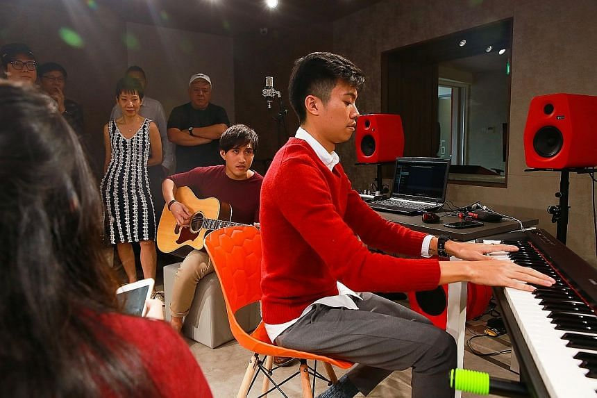 Music producer Joshua Goh, 26, on keyboard, and freelance musician Marcus Lee, 26, on guitar, composing a chorus at The Songwriter Music College, a partnership between content producer mm2 Asia and music company Funkie Monkies.