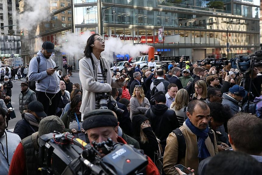 Journalists outside Time Warner Centre in New York City after a suspicious package was found in CNN's headquarters on Oct 24, forcing staff to evacuate. CNN, one of President Donald Trump's targets in rants against the media, was among the parties wh