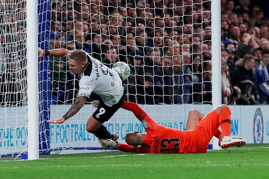 Top: Derby County striker Martyn Waghorn scoring his team's second equaliser past Chelsea goalkeeper Willy Caballero shortly before the half-hour mark in the 3-2 League Cup round-of-16 loss at Stamford Bridge on Wednesday. Above: Former Chelsea star