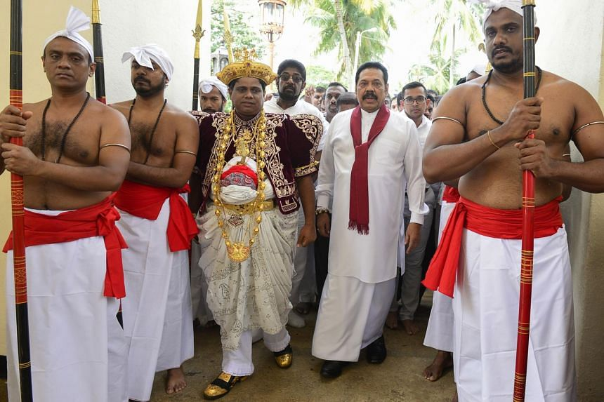 President Maithripala Sirisena sacked Ranil Wickremesinghe as prime minister last Friday and named former strongman president Mahinda Rajapakse (second from right) as his replacement.