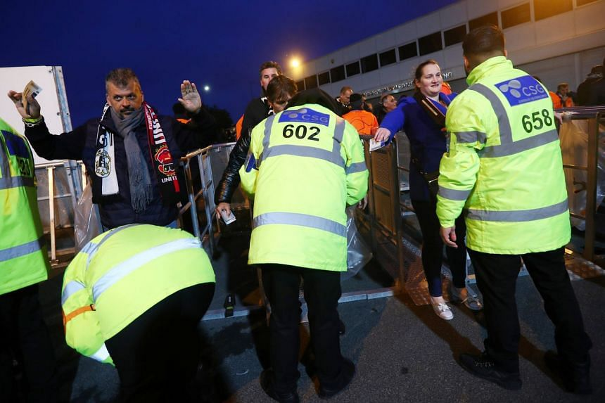 Fans are searched by security staff outside Old Trafford before the Champions League match between Manchester United and Juventus on Oct 23, 2018.