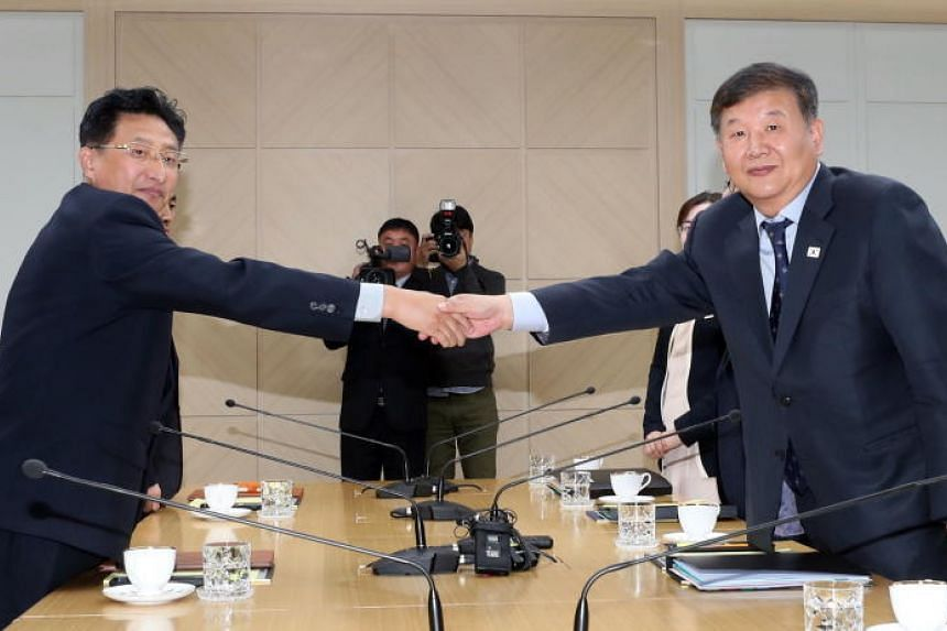 South Korea's vice-minister of culture and sports Roh Tae-kang and his North Korean counterpart Won Kil U at the start of their talks at the inter-Korean liaison office in the border town of Kaesong on Nov 2, 2018.