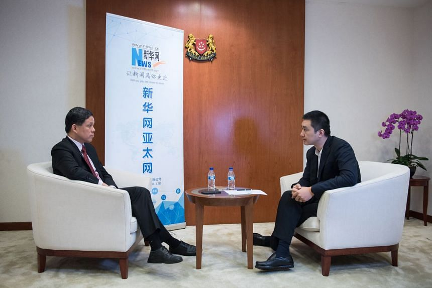 During an interview with Xinhuanet, Trade and Industry Minister Chan Chun Sing (left) said the enhanced trade pact will provide Singapore businesses with greater trade facilitation and investment protection in China.