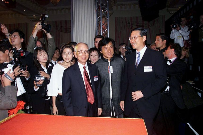 Mr Raymond Chow with actor Jackie Chan at the Cannes Film Festival in Hong Kong in 2001.