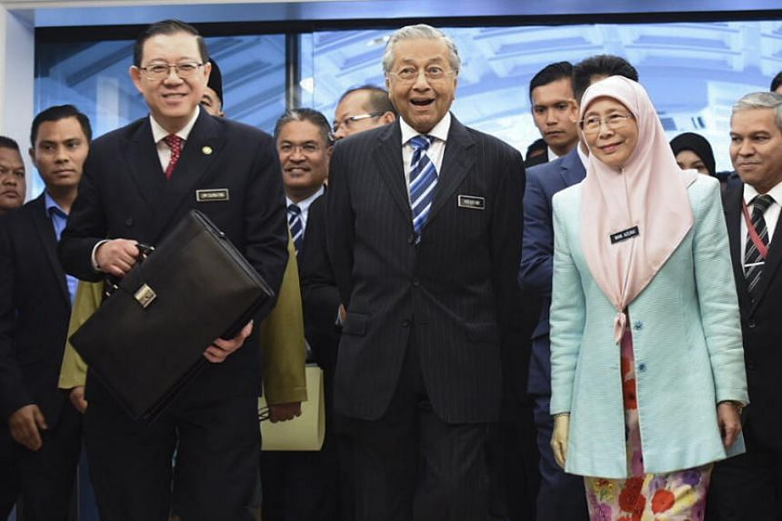 (From left) Malaysia's Finance Minister Lim Guan Eng, Prime Minister Mahathir Mohamad and Deputy Prime Minister Wan Azizah Wan Ismail arriving at Parliament House in Kuala Lumpur for the Budget 2019 presentation on Nov 2, 2018.