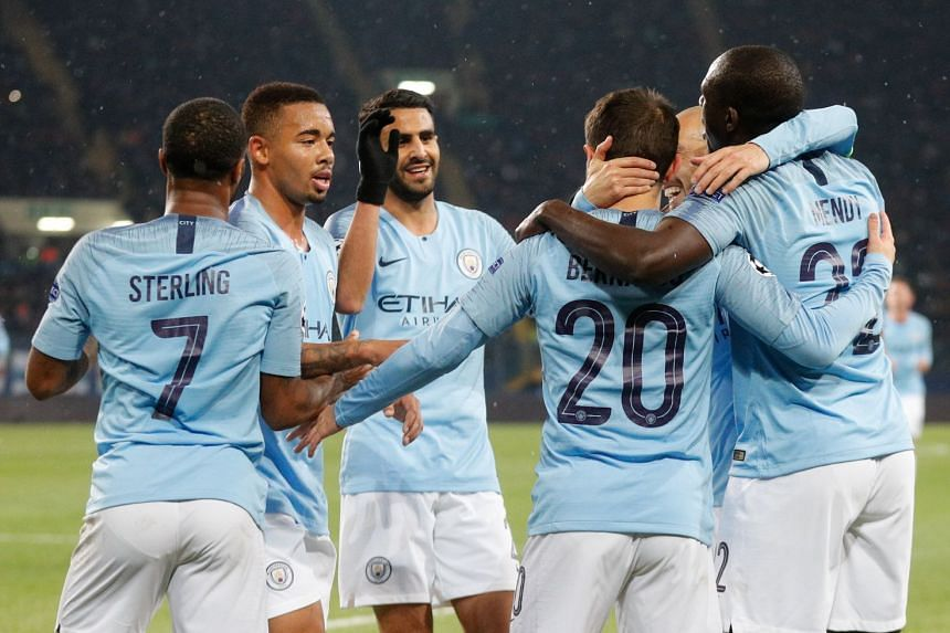Manchester City players celebrate a goal during a Uefa Champions League match.