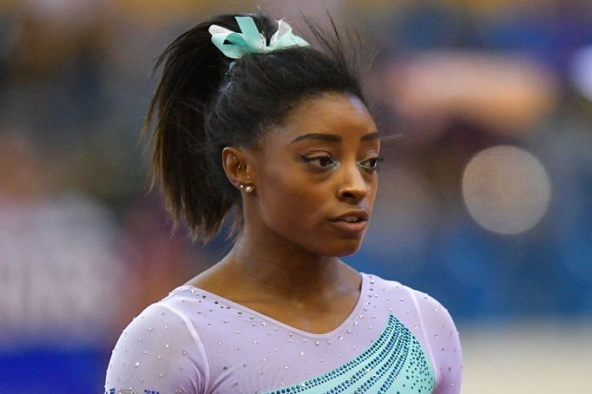 Biles (above) broke the all-time record set by Belarusian male gymnast Vitaly Scherbo in 1996.