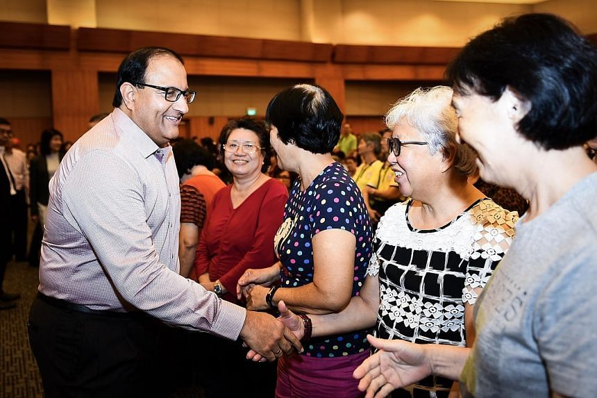 Mr S. Iswaran greeting attendees at the Institute of Technical Education College East's Service Learning Day yesterday, where students held a series of events for seniors, including on how to identify fake news.