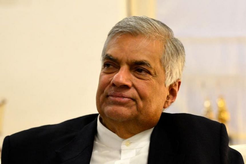Sri Lanka's ousted prime minister Ranil Wickremesinghe had refused to accept his dismissal and has not left the sprawling colonial-era Temple Trees residence since.