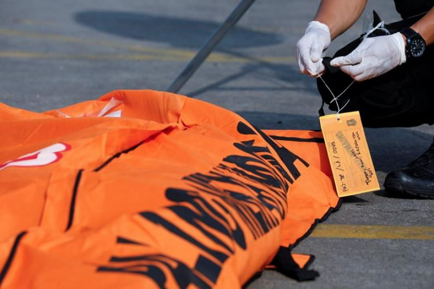 A rescue worker of the crashed Lion Air flight JT610 labels a body bag at the Tanjung Priok port in Jakarta on Nov 2, 2018.