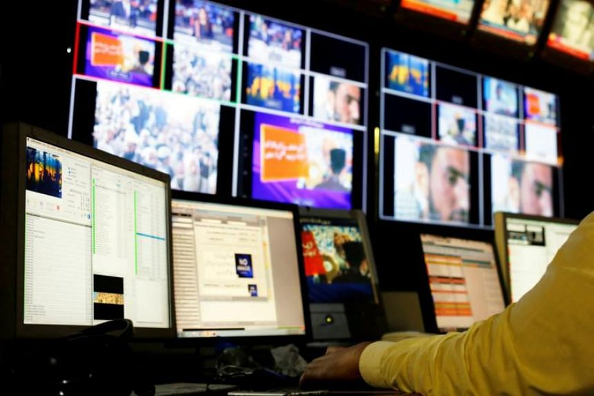 File photo of an employee working at the control room of the Geo News television channel in Karachi.