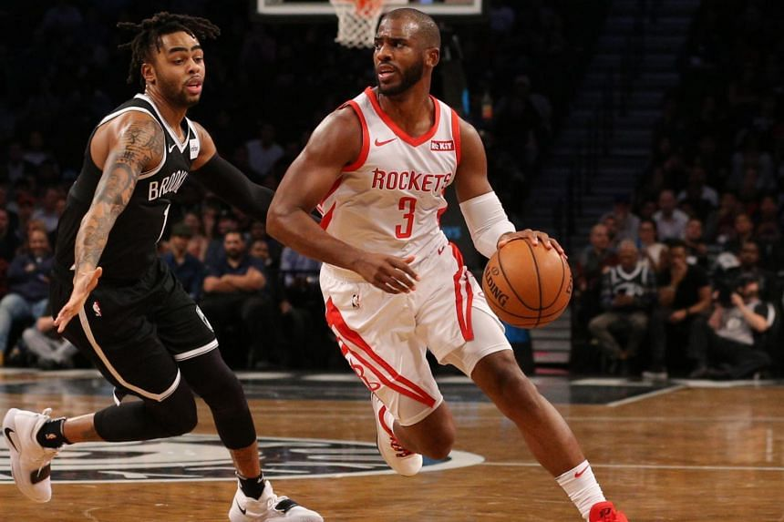 db8f5c8961e Chris Paul (right) drives around D Angelo Russell during the match between  the