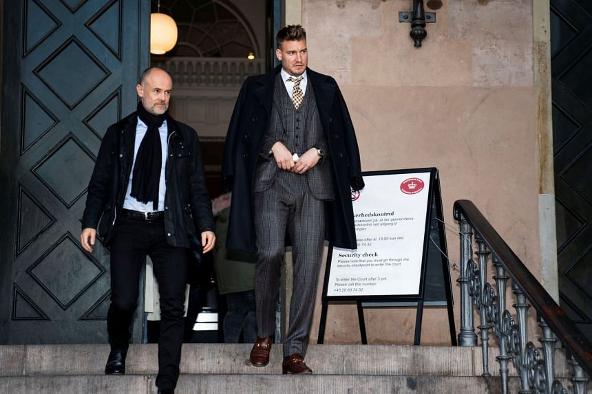 Nicklas Bendtner and his lawyer Anders Nemeth leaving Copenhagen City Court, on Nov 2, 2018, after he was sentenced to unconditional imprisonment for 50 days over violence against a taxi driver in Copenhagen.