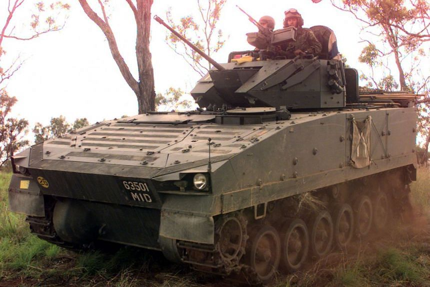 File photo of Singapore Armed Forces (SAF) personnel driving an SAF-made Bionix vehicle during an overseas exercise.