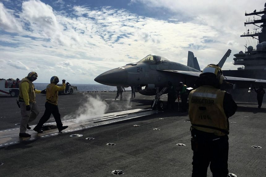 The nuclear powered USS Ronald Reagan aircraft carrier is joined by Japanese destroyers and a Canadian warship for the biennial Keen Sword exercise, with 57,000 sailors, marines and airmen mobilised by Japan and the US.