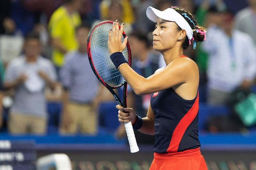Wang reacts during her women's singles semi-final against Garbine Muguruza of Spain.