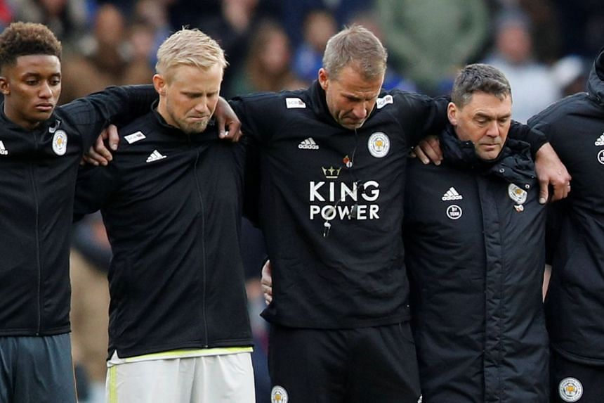 Leicester City's Kasper Schmeichel with fellow players and staff during a minute's silence.