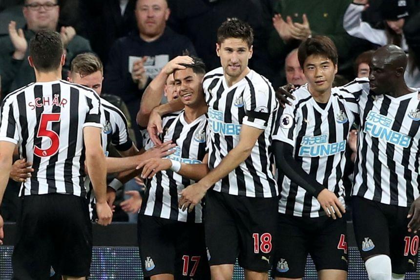 Newcastle United's Ayoze Perez celebrates scoring with team mates.