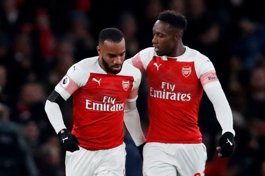 Arsenal's Alexandre Lacazette celebrates with Danny Welbeck after scoring.