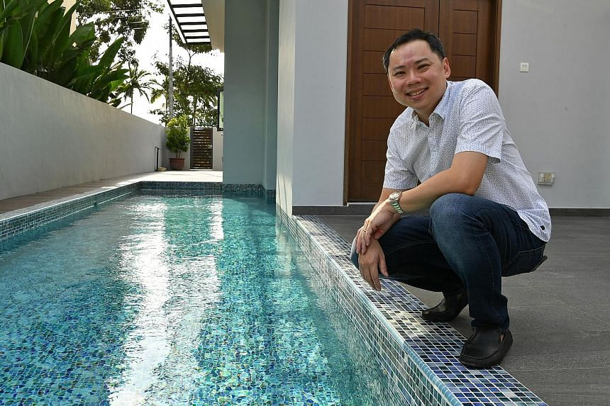 Mr Darren Teo and his favourite part of his Seletar Hills Estate home - the swimming pool, which has an in-built jacuzzi.
