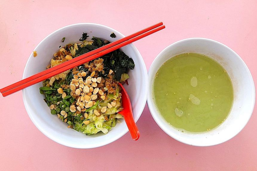 The broth of Traditional Hakka Lui Cha's thunder tea rice is nutty and herbaceous.