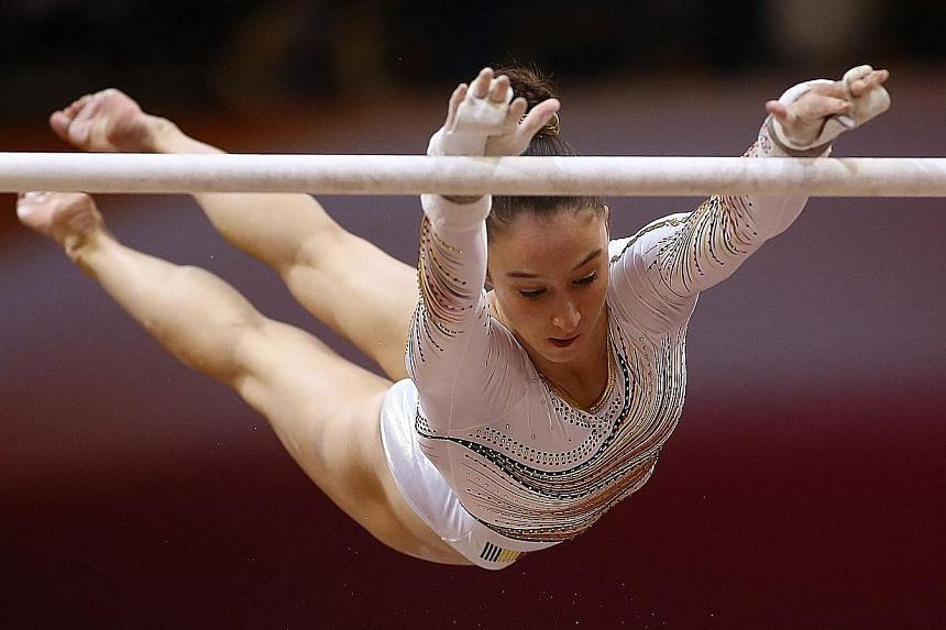 The gold that got away from Simone Biles was won by Nina Derwael (above), whose high-energy, uneven bars routine secured a score of 15.200 to make her Belgian's first world champion.