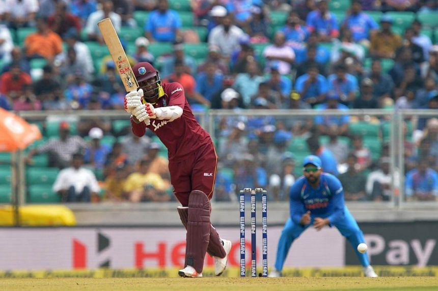 West Indies batsman Marlon Samuels plays a shot during the fifth one day international cricket match against India, on Nov 1, 2018.
