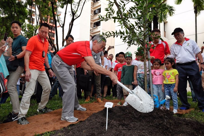Prime Minister Lee Hsien Loong plants trees with residents at Fernvale Lane on Nov 4, 2018.