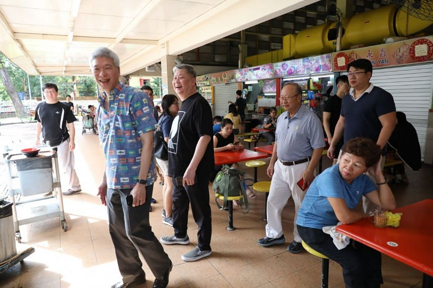Former presidential candidate Tan Cheng Bock (second from right) and Mr Lee Hsien Yang (left) were at Block 726 West Coast Market, which is in Dr Tan's former Ayer Rajah constituency when he was an MP with the People's Action Party from 1980 to 2006.