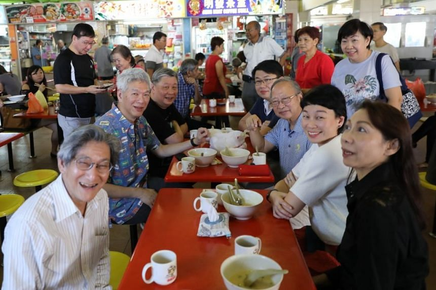 Former presidential candidate Tan Cheng Bock (seated, third from right) and Mr Lee Hsien Yang (seated, second from left) were at Block 726 West Coast Market, which is in Dr Tan's former Ayer Rajah constituency when he was an MP with the People's Acti